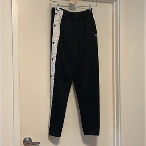 PUMA SIDE SNAP TRACK PANTS IN BLACK + WHITE